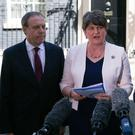 DUP leader Arlene Foster is joined outside 10 Downing Street by deputy leader Nigel Dodds (left) and MP Jeffrey Donaldson