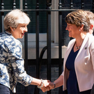 Prime Minister Theresa May shakes hands with DUP leader Arlene Foster outside 10 Downing Street yesterday