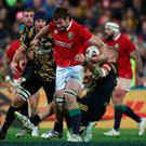 Iain Henderson of the Lions is tackled by Brad Shields of the Hurricanes during the 2017 British & Irish Lions tour match between the Hurricanes and the British & Irish Lions at the Westpac Stadium on June 27, 2017 in Wellington, New Zealand. (Photo by David Rogers/Getty Images)