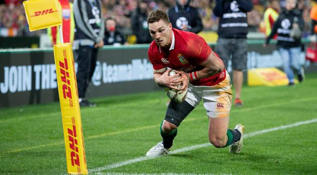 British and Irish Lions winger George North stands on the line as dives for a try which is disallowed against the Hurricanes in Wellington, New Zealand, Tuesday, June 27, 2017. (Brett Phibbs/New Zealand Herald via AP)