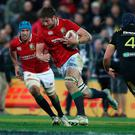 On the attack: Iain Henderson on the charge for the Lions against the Hurricanes in Wellington yesterday. Photo: David Rogers/Getty Images