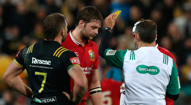Yellow peril: Iain Henderson gets carded against the Hurricanes yesterday. Photo by David Rogers/Getty Images