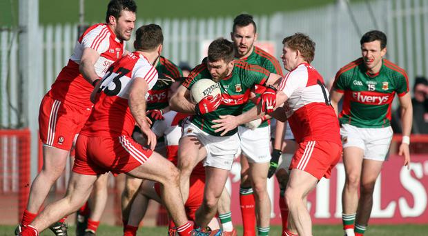 Reunited: Mayo's Seamus O'Shea with Derry's Mark Lynch, Emmet McGuckin and Enda Lynn in a league clash back in 2015. Photo: Lorcan Doherty/INPHO