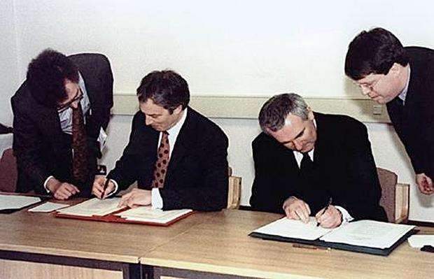 Tony Blair and Bertie Ahern sign the Belfast Agreement