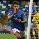 That's my boy: Jordan Stewart slots in Linfield's late winner last night.