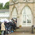 Claire Bailey and Steven Agnew of the Green Party talk to the media as rain falls on Stormont Castle in east Belfast where local parties are holding talks ahead of this afternoon's deadline to get the Northern Ireland Assembly up-and-running. Picture by Jonathan Porter/PressEye.com