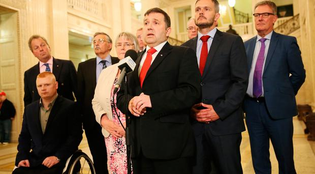 Ulster Unionist Leader Robin Swann (centre) speaks to the media at Stormont, Belfast, as Stormont's political leaders are set to miss a deadline to restore powersharing in Northern Ireland after a scheduled Assembly sitting to nominate ministers was axed. Brian Lawless/PA Wire