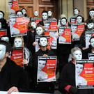 Northern Ireland women protest by wearing masks representing those who leave for England each week to have an abortion that they must pay for themselves