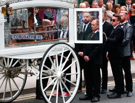 STOCKPORT, ENGLAND - JUNE 30: Martyn Hett's father Paul Hett (3rd R) stands by the coffin of his son as it arrives at Stockport Town Hall for Martyn Hett's funeral service on June 30, 2017 in Stockport, England. 29 year old Martyn Hett was one of 22 people who died in the suicide bombing at Manchester Arena after attending an Ariana Grande concert. Scottish singer Michelle McManus will perform at the service which will be screened outside for anyone who cannot fit inside the venue. (Photo by Dave Thompson/Getty Images)