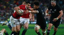 Conor Murray of the Lions hands off Ardie Savea of the All Blacks to score his team's second try
