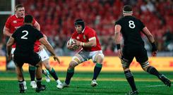 Sean O'Brien of the Lions charges towards Codie Taylor and Kieran Read.