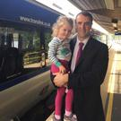 Mark H Durkan MLA and his daughter Lily at Waterside Railway Station