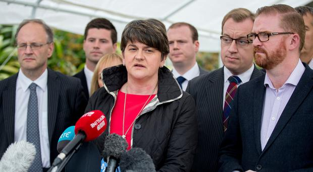 DUP leader Arlene Foster speaking to the media accompanied by party colleagues at Stormont Castle, Belfast, as talks aimed at restoring powersharing in Northern Ireland continue. [Photo: Liam McBurney/PA Wire