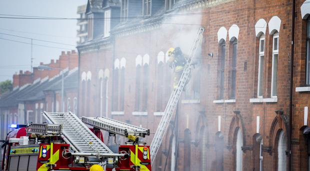Fire Fighters battle a blaze at a property in the Stratheden Street area of the Newlodge, North Belfast on July 3rd 2017 (Photo by Kevin Scott / Belfast Telegraph)