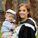 Bronagh Nic Mathuna is celebrating graduation success at Queens University. Bronagh, pictured here with her son Elijah (3) graduated with a degree in Irish.