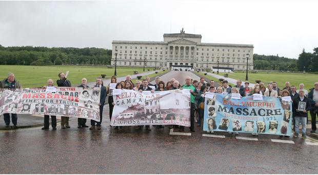 John Teggart , who lost a relative in the Ballymurphy massacre pictured with other relatives during a protest at Stormont. Pacemaker