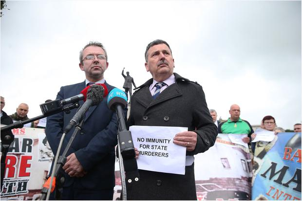 John Teggart (right), who lost a relative in the Ballymurphy massacre pictured with other relatives during a protest at Stormont. Pacemaker