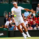 Roger Federer during the Gentlemen's Singles first round match against Alexandr Dolgopolov of Ukraine on day two at Wimbledon