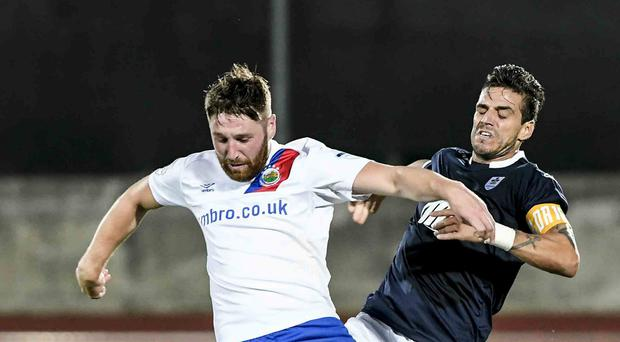 Linfield's Mark Stafford and La Fiorita's Danillio Ezequel during this evenings game in San Marino.