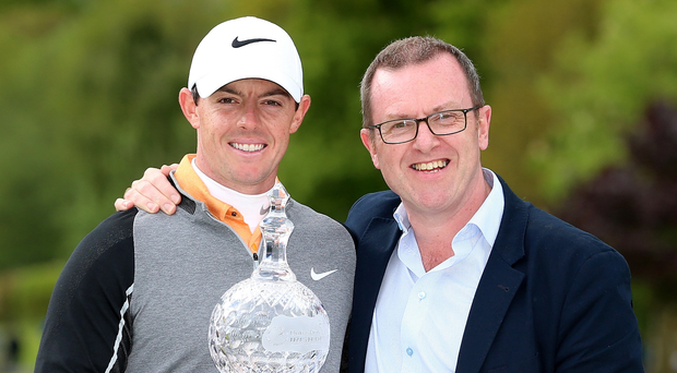 Special moment: Rory McIlroy and Barry Funston after the Holywood superstar won the Irish Open at the K Club last year
