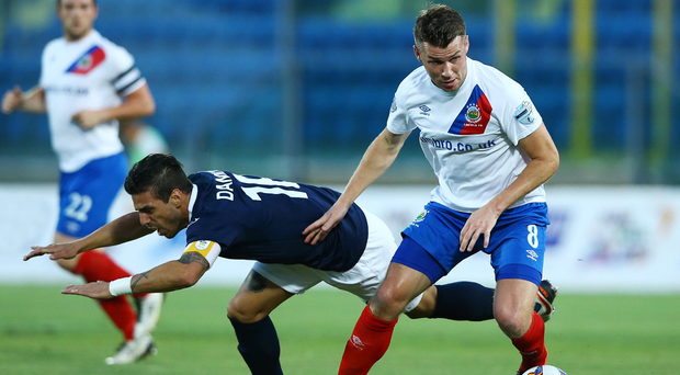 Full control: Linfield's Stephen Lowry gets the better of Danilo Rinaldi