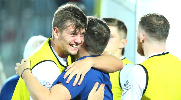 Linfield players celebrate at the final whistle in San Marino