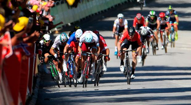 International flavour: The Tour de France having departed Germany via Belgium and Luxembourg, Slovakian Peter Sagan gives Manxman Mark Cavendish the Spanish Archer