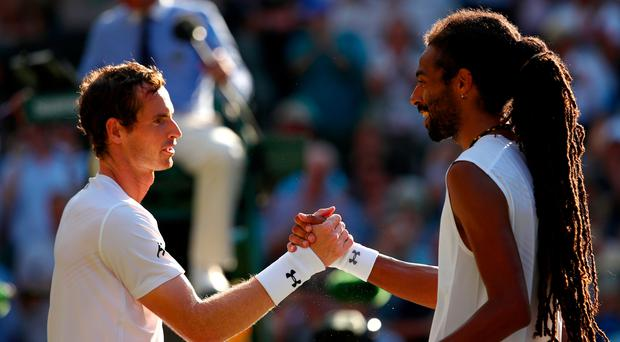 Job done: Andy Murray after beating Dustin Brown on Centre Court yesterday