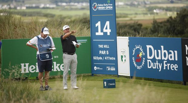 Graeme McDowell playing on the 14th hole during round one of the Dubai Duty Free Irish Open.