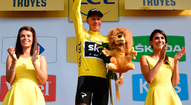 Christopher Froome celebrates his overall leader yellow jersey on the podium at the end of the 216 km sixth stage of the Tour de France yesterday. Photo: Getty Images