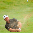 Graeme McDowell chips from a bunker on the 18th hole during day one of the Irish Open at Portstewart Golf Club. Photo: Warren Little/Getty Images
