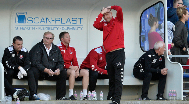 Pure agony: Stephen Baxter and the Crues bench after conceding in the final seconds