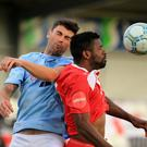 Ballymena's Johnny Flynn and Odd BK's Olivier Occean during this evening's game at Seaview, Belfast.