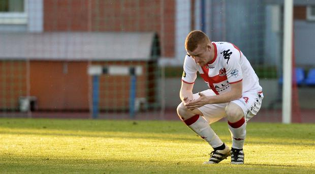 Crusaders Rodney Brown shows his disappointment at losing to a last minute goal