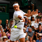 Winners: Roger Federer on the way to victory at Wimbledon yesterday. Photo: Shaun Botterill/Getty