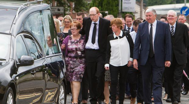 Johnathan Smyth, fiance of Jolene O'Hagan, and family follow the funeral cortege at Derryloran Parish Church