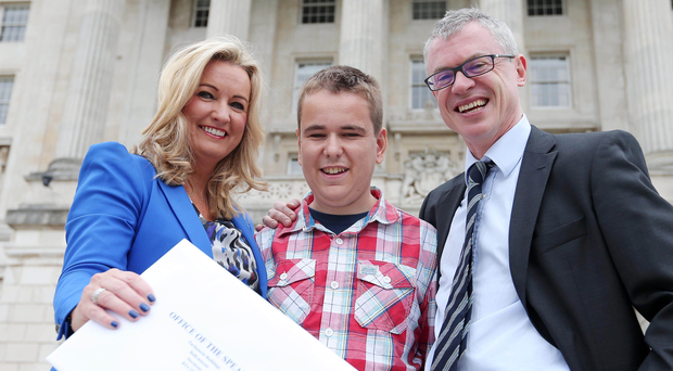 Life changing: the UUP's Jo-Anne Dobson submits her Private Member's Bill on organ donation to the Office of the Speaker in September 2015. With her is son Mark, who received a transplant, and former GAA player and organ donor Joe Brolly