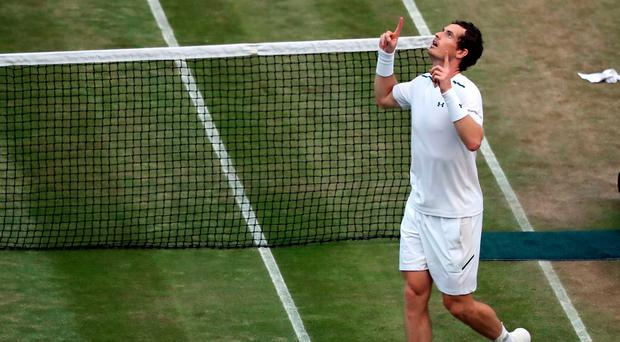 Andy Murray celebrates beating Fabio Fognini on day five of the Wimbledon Championships at The All England Lawn Tennis and Croquet Club, Wimbledon. John Walton/PA Wire.