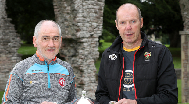 Prize guys: Mickey Harte and Eamonn Burns with the Ulster crown