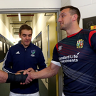Shake on it: All Blacks captain Kieran Read with Lions skipper Sam Warburton ahead of the second Test