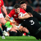 British and Irish Lions' Johnny Sexton is tackle by New Zealand's Codie Taylor and Owen Franks during the third test at Eden Park, Auckland. Photo: David Davies/PA