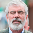 Poles apart: Gerry Adams (pictured) is a late convert to the peaceful nationalism espoused by John Hume
