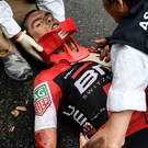Down: Richie Porte receives medical attention after crash