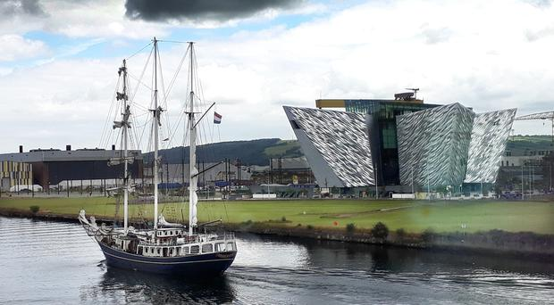 The Thalassa tall ship makes its way past the Titanic building. [Photo by Peter Rainey, Belfast Telegraph]