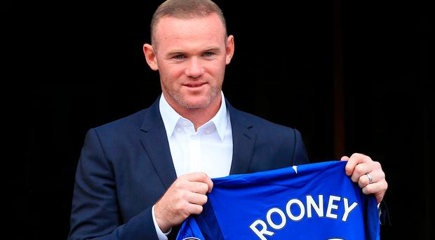 Perfect 10: Wayne Rooney shows off his Everton shirt