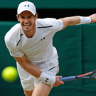 On his way: Andy Murray hits a return en route to reaching the quarter-finals at Wimbledon for the 10th year in a row