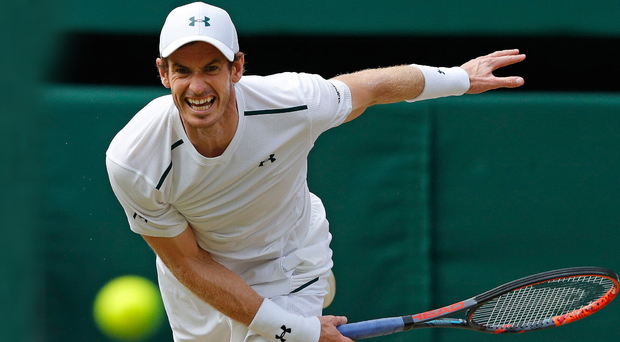 On his way Andy Murray hits a return en route to reaching the quarter-finals at Wimbledon for the 10th year in a row