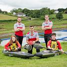Ulster Rugby stars Louis Ludik, David Busby and Craig Gilroy launch the Junior International Canoe Polo Championships with Ulster Canoe Polo team members Katie Ashe and Cavan Fayle.