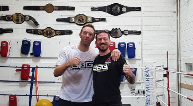 Coldplay's Chris Martin with Conor McGregor's coach John Kavanagh.