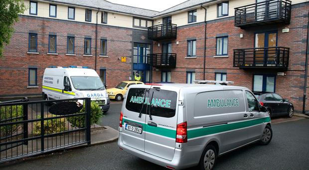 A coroners ambulance arrives at a complex in Poddle Park, Kimmage, Dublin, where a three-year-old boy was found dead following a stabbing. Niall Carson/PA Wire